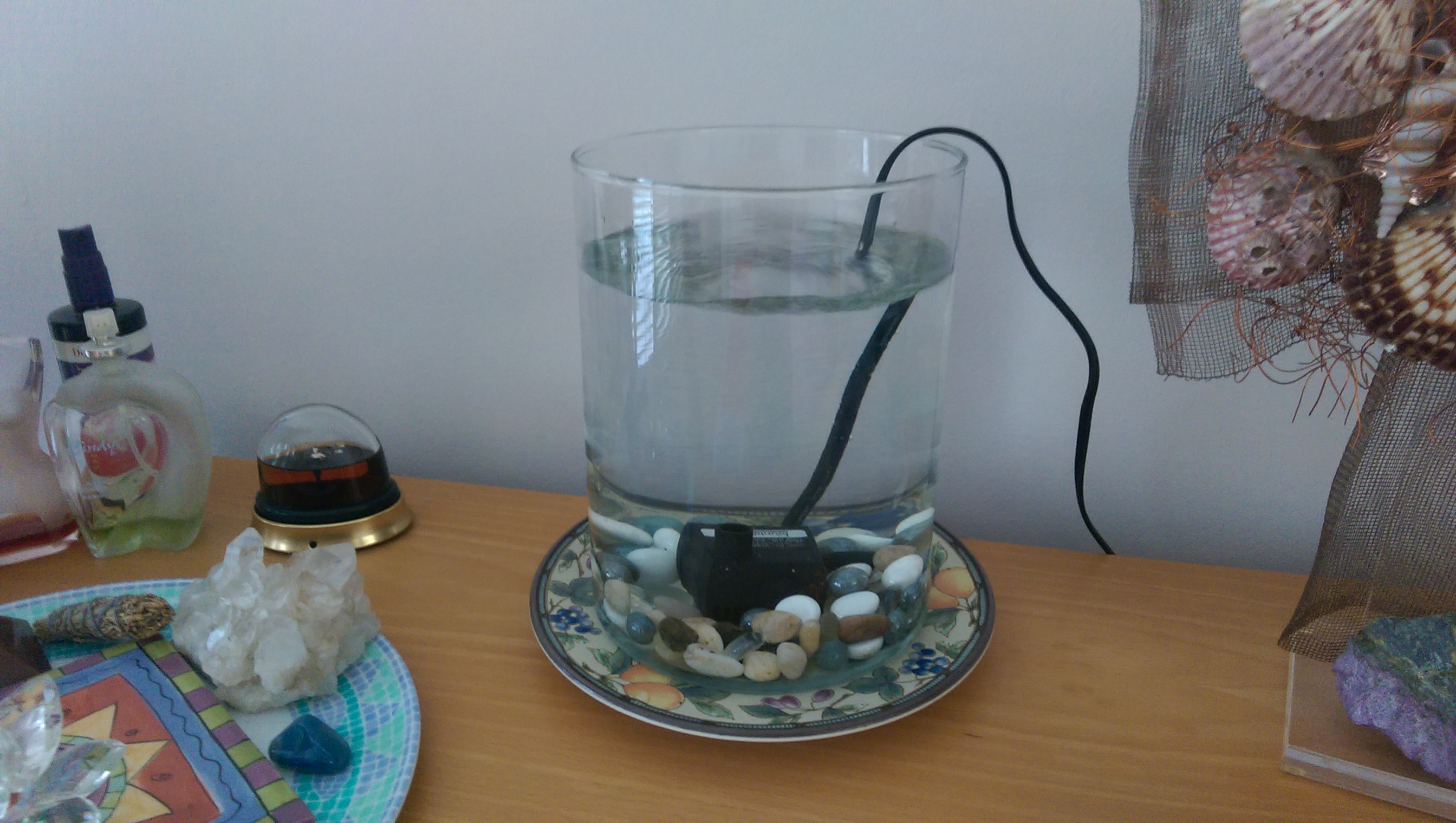 Make Indoor Fountain How to make a home made indoor water fountain by kartar diamond you can make an inexpensive indoor fountain with a pump and a container without doing any drilling on the container the pump cord will need to drape over workwithnaturefo